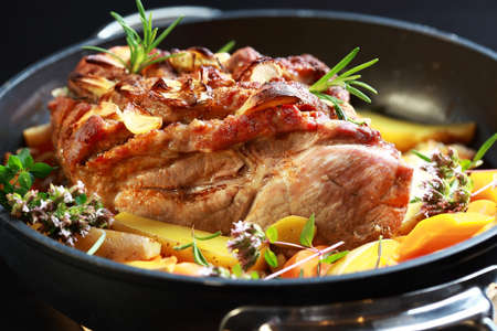 Tasty roasted pork meat with western potatoes and vegetable  photo