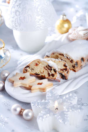 Still life with delicious Christmas cake and cookies photo