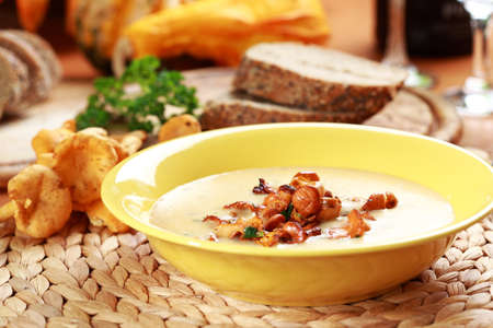 Cream of chanterelle mushroom soup with herbs photo