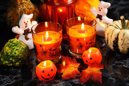 Halloween candle-light with pumpkins on black background Stock Photo - 10743382