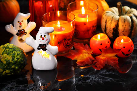 horribly: Halloween candle-light with pumpkins on black background Stock Photo