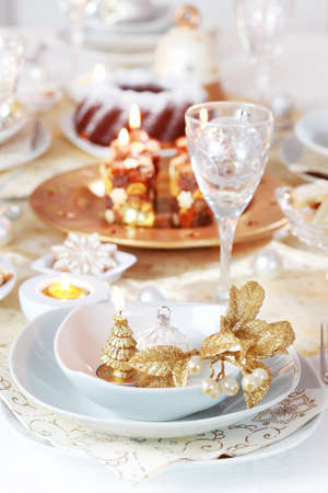 Place setting for Christmas in golden and white tone photo