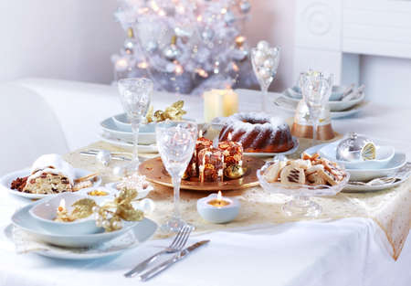 Place setting for Christmas in white tone photo