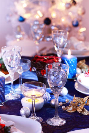 Place setting for Christmas in blue and white tone photo