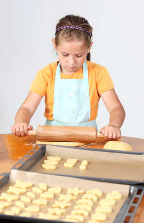Cute girl baking cookies for Christmas Stock Photo - 10932422