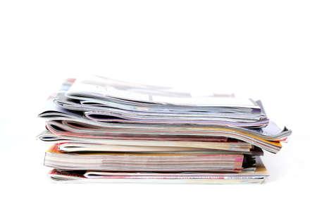 Batch of magazines isolated on white photo