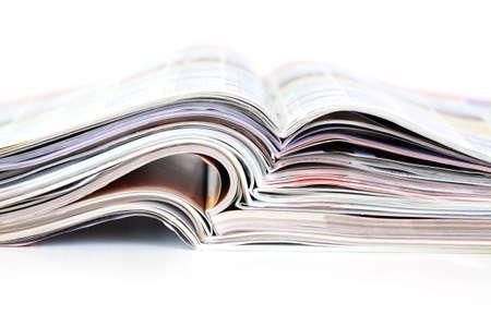 batch: Batch of open magazines, close-up