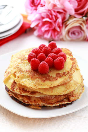 Sweet pancakes with fresh raspberries photo