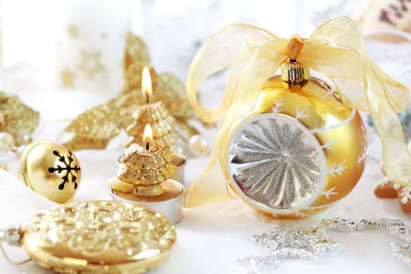 Christmas decoration with ball and candles in golden tone photo