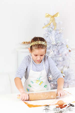 Cute girl baking cookies for Christmas Stock Photo - 11144225