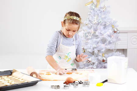 Cute girl baking cookies for Christmas Stock Photo - 11144195