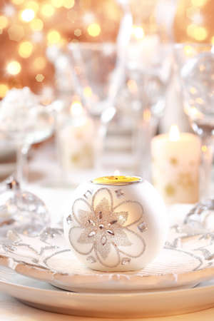 Place setting for Christmas in white and golden tone photo