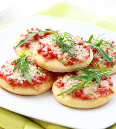 cakes and pastries: Small cakes with ham and cheese as appetizer