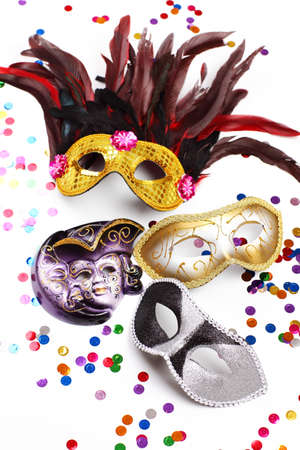 Carnival mask with confetti on white background photo