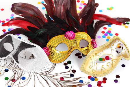 masque: Carnival mask with confetti on white background Stock Photo
