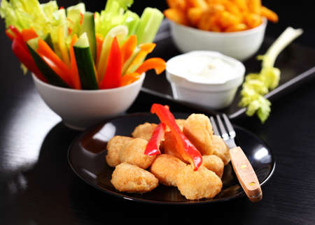 Chili cheese nuggets with raw vegetable and dip photo