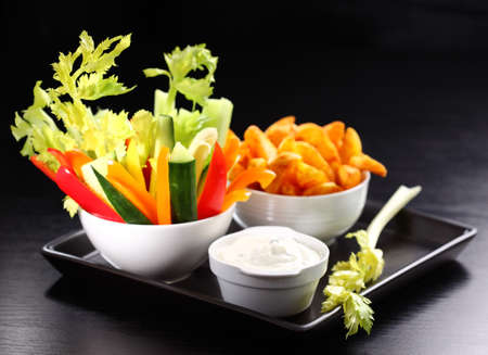 Raw vegetable and wedges with cream cheese dip photo