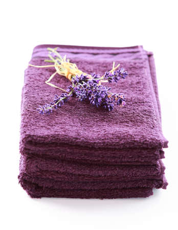 towels luxury: Stack of towels with lavender on white background