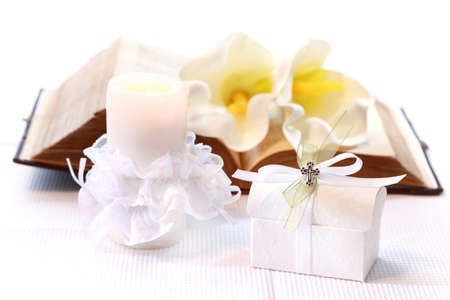 first communion: First holy communion or confirmation - candle, open bible and small present Stock Photo