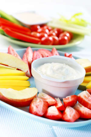 sliced cheese: Raw  fruits and vegetables with cream cheese and yogurt dip Stock Photo