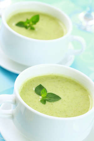 Soup of green vegetables with fresh herbs photo