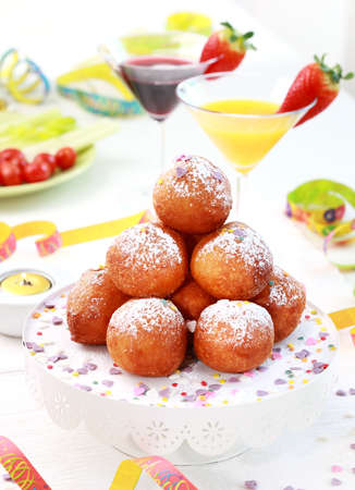 Small fried doughnut with cocktails for carnival photo