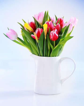 Home appliance - beautiful spring flowers in vase on the table photo