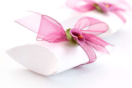 Small gift box decorated with ribbon and flower