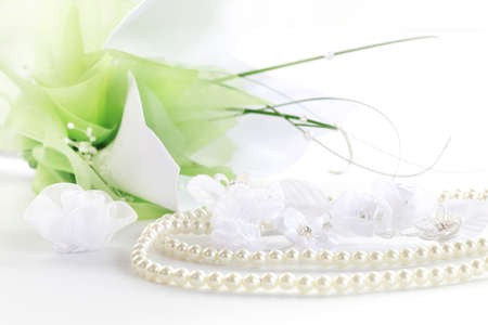 pearl necklace: Wedding still life with necklace and bouquet in background