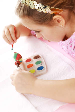 creative egg painting: Cute little girl painting Easter eggs