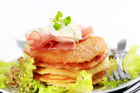 jewish cuisine: Delicious potato pancakes with curd cheese and herbs