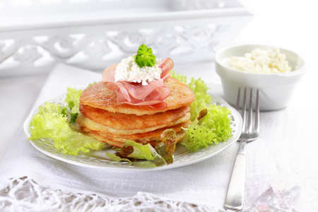 jewish food: Delicious potato pancakes with curd cheese and herbs
