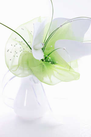 Luxury bouquet as table decoration in white and green photo