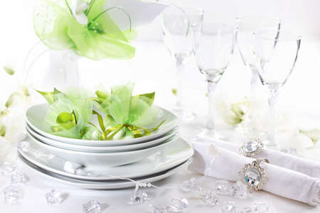 Luxury place setting for wedding in white and green tone photo