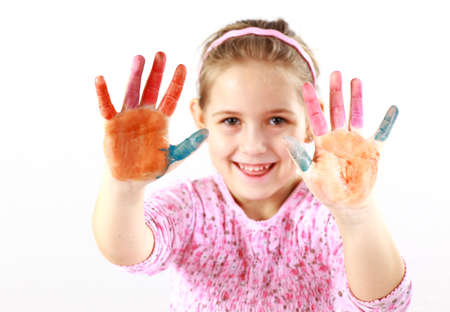 Little girl with painted hands on white background photo