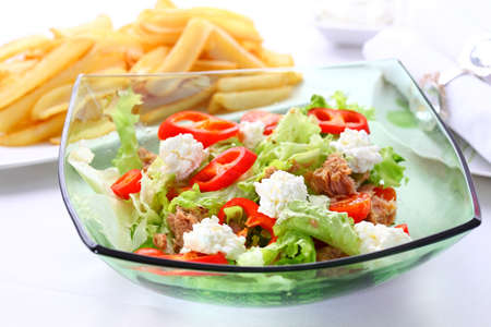 tuna salad: Mixed vegetable salad with tuna, cottage cheese and baked potatoes in background Stock Photo