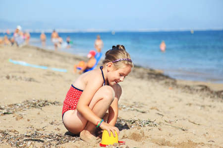 children sandcastle: Kids playing with plastic toys on the beach