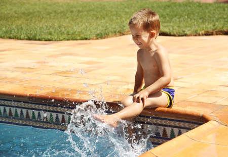 enjoyment: Happy boy having a fun at swimming pool Stock Photo