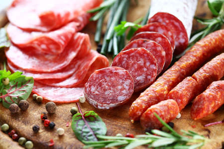 meat dish: Different Italian ham and salami with herbs