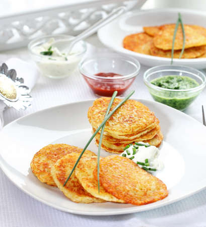 Potatoe pancakes with three different dips Stock Photo - 13108297