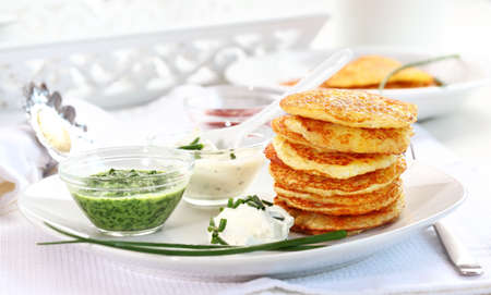 Potatoe pancakes with three different dips photo