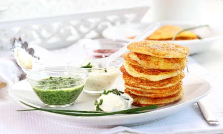 jewish cuisine: Potatoe pancakes with three different dips Stock Photo