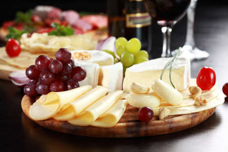 cheese platter: Cheese and salami platter with vegetable and herbs Stock Photo