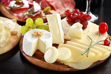 cheese plate: Cheese and salami platter with vegetable and herbs Stock Photo