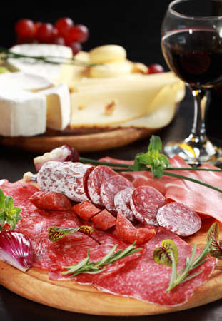 cheese platter: Salami and cheese platter with vegetable and herbs