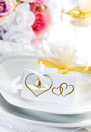 Wedding place setting in white nad golden tone photo