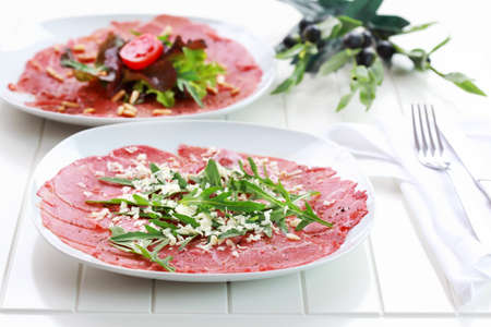 Carpaccio with rocket and cheesse
