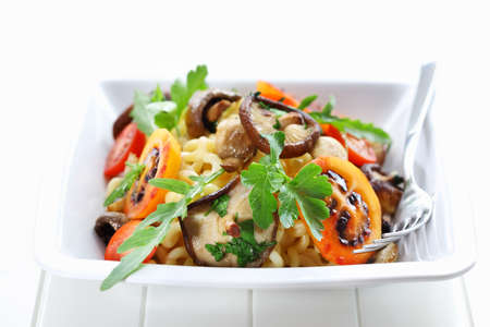 Pasta with mushrooms, tamarillos and herbs photo