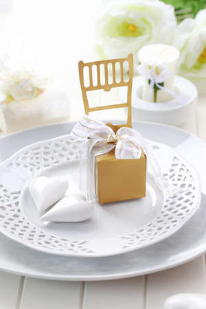 Luxury place setting in white and golden tone photo