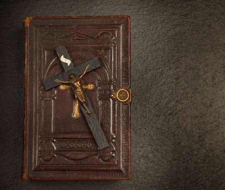 Old bibel with The Cross on dark background Stock Photo - 13831416